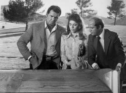 James Garner as Jim Rockford, Sian Barbara Allen as a newspaperwoman and Dave Morick as the county coroner from the television program The Rockford Files.